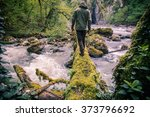 man traveler crossing river on... | Shutterstock . vector #373796692
