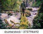 Man Traveler Crossing River On...