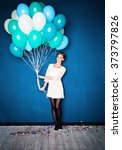 happy girl with blue balloons.... | Shutterstock . vector #373797826