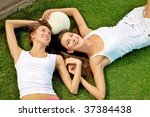 two happy young girls lying... | Shutterstock . vector #37384438