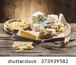 Variety Of Cheeses On A Wooden...