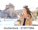 Happy Beautiful Woman Walking...