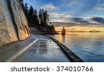 Stock photo seawall and rock wall at sunset with famous siwash rock in the sea water stanley park vancouver 374010766