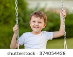 happy little boy playing on... | Shutterstock . vector #374054428