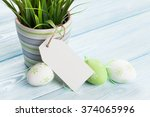 Easter Eggs And Potted Plant O...