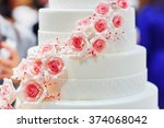 white wedding cake decorated... | Shutterstock . vector #374068042