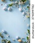 easter eggs and spring flowers...   Shutterstock . vector #374099782