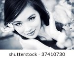 Young woman with cherry flowers. Dark blue and white colors. - stock photo