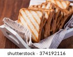 toasted bread  on a wooden | Shutterstock . vector #374192116