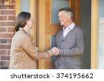 woman checking on elderly male... | Shutterstock . vector #374195662