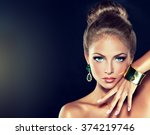 fashion woman with jewelry . girl with the hair ban and fashionable jewelry , earrings ,bracelets