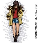 fashion girl in a cap and... | Shutterstock .eps vector #374269612