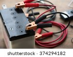 a car battery with red and... | Shutterstock . vector #374294182
