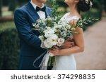 wedding. the groom in a suit... | Shutterstock . vector #374298835