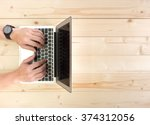 male hands working on a laptop...   Shutterstock . vector #374312056