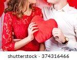 Couple Holding Heart Shaped...