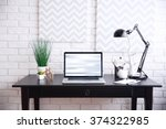 workplace with laptop on table... | Shutterstock . vector #374322985