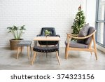 cozy sofa corner with christmas ... | Shutterstock . vector #374323156