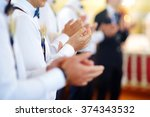 groomsmen during catholic... | Shutterstock . vector #374343532