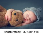 Sleeping Newborn Baby On A...