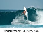 A Male Surfer Executes A...