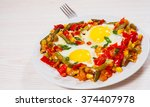 fried eggs with mixed... | Shutterstock . vector #374407978
