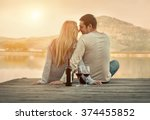 romantic couple sitting on the... | Shutterstock . vector #374455852