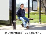 Middle Age Man Sitting On Bench ...