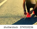 young sports woman runner tying ... | Shutterstock . vector #374510236