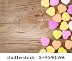 Colorful Candy Hearts On Woode...