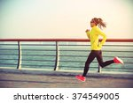 Young fitness woman runner...