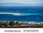 lagoon full of windsurfers in...   Shutterstock . vector #374553925