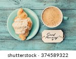 coffee mug with croissant and... | Shutterstock . vector #374589322