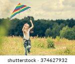 little cute girl flying a kite... | Shutterstock . vector #374627932