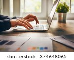 businessman using laptop... | Shutterstock . vector #374648065