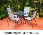 Table And Chairs On The Terrac...
