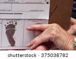 doctor recording a newborns... | Shutterstock . vector #375038782