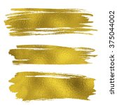 gold texture paint stains. hand ... | Shutterstock . vector #375044002