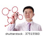 Asian businessman drawing an chart on transparent  board - stock photo