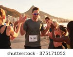 group of young adults cheering...   Shutterstock . vector #375171052