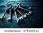 Bunch Of Old Keys On Dark...