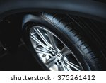 luxury car wheel close up | Shutterstock . vector #375261412