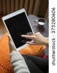 Woman Using Digital Tablet At...
