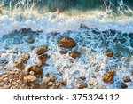 High Tide On A Rocky Beach At...