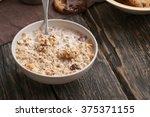 tasty oatmeal porridge with... | Shutterstock . vector #375371155