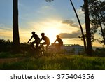 Silhouettes Of Cyclists In A...