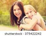hugging happy mother and... | Shutterstock . vector #375422242
