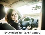 woman in car indoor keeps wheel ... | Shutterstock . vector #375468892