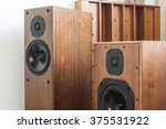 Small photo of A vintage(old) wood(walnut, teak, cherry) speaker(tallboy, bookshelf) on the listening(audio) room.