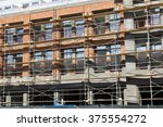 scaffolding used in front of a... | Shutterstock . vector #375554272